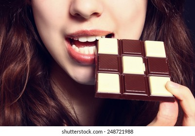 Closeup of woman eating chocolate
