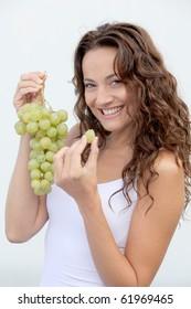 Closeup of woman eating grapes