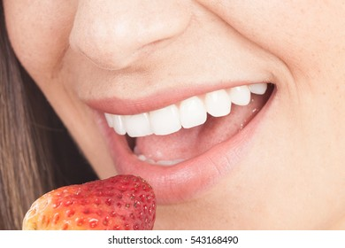 Close-Up woman eating a strawberry