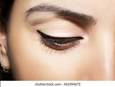 Closeup of woman eye  with black eyeliner
