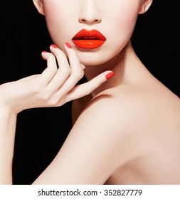 Closeup of woman face and body. Beautiful makeup with red lips, nail polish manicure.isolated on black.