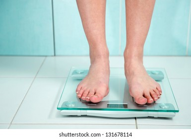 close-up of woman feet weighing in bathroom