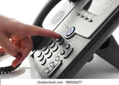 closeup of woman finger  dialing a telephone number to make a phone call
