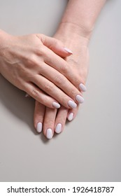 Close-Up Of Woman Fingers With Nail Art. Woman Hand With Pearl Nail Polish