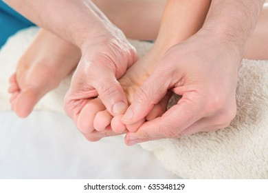 Close-up of woman foot receiving massage Treatment from a therapist