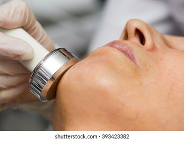 Close-up of a woman getting ultrasound skin cleaning