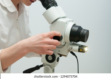 Closeup woman gynecologist working with colposcope