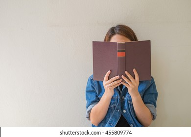 Closeup woman hand holding a book to read