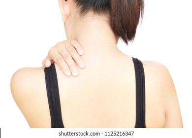 Closeup woman hand holding neck or shoulder with pain on white background, health care and medical concept