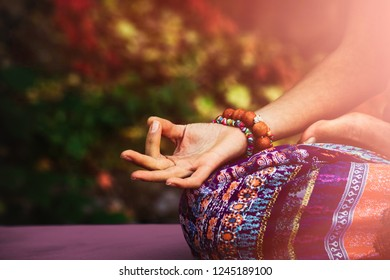 closeup of woman hand in mudra gesture practice yoga meditation outdoor autumn day