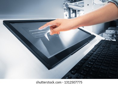 Closeup of woman hand is touching interactive screen monitor for typing input username and password in security verification system. Technology communication network and business connecting web.