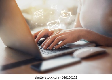 Closeup Woman hand using Laptop pc with email icon, Email concept
