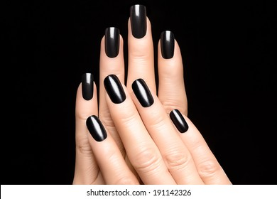 Closeup of woman hands with black nails. Manicure