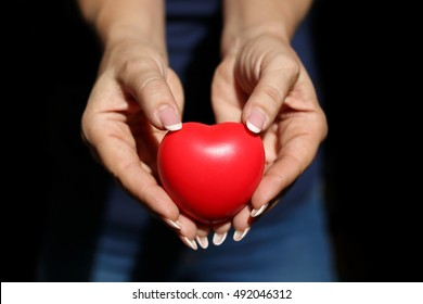 closeup of woman  hands showing red heart