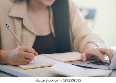 Closeup woman hands using computer laptop.