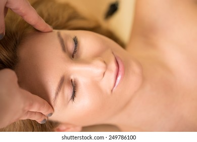 Close-up of woman having her head massaged