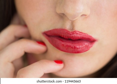 Close-up of woman having red lips