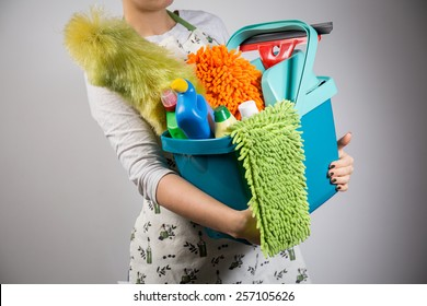 Close-up of woman holding bucket full of cleaners