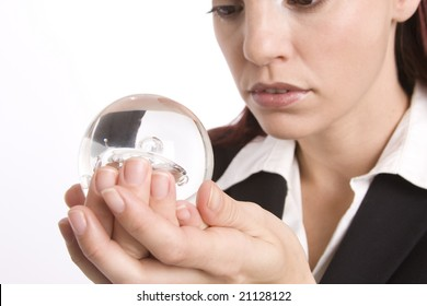 Closeup of a woman holding a crystal ball in her hand