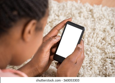 Close-up Of Woman Holding Mobile Phone With Blank Screen