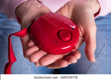 Close-up Of Woman Holding Personal Alarm On Her Hands