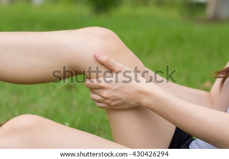 5cd90c3ec3 Close-up woman holding sore leg muscle while jogging. Cramp in leg. Sport
