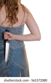 closeup woman with knife behind her back