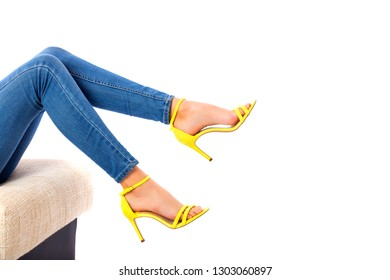 Closeup of woman legs against white background.
