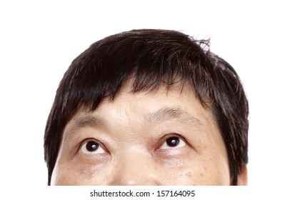 Close-up of woman looking up. Isolated on white background.