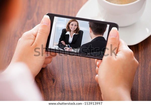 Close-up Of Woman Looking At Video Conference On Mobile Phone