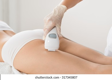 Close-up Of Woman Lying And Receiving Laser Hair Removal Treatment