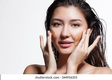 Closeup of a woman making a face peeling scrub