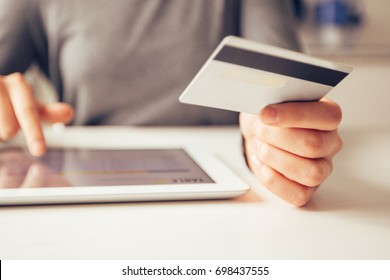 Closeup of Woman Making Online Payment on Tablet