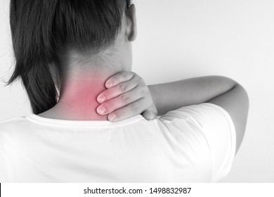 Closeup woman neck and shoulder feeling exhausted and suffering from neck and shoulder pain and injury on white background. Health care and medical concept.