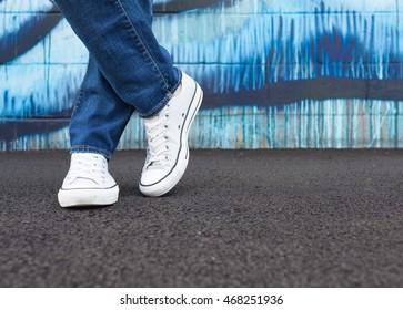 Closeup of woman posing in sneakers.