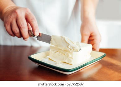 Closeup of woman preparing butter for Christmas Cookies
