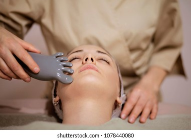 Closeup of woman receiving face massage in a holistic clinic