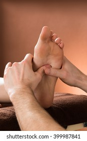 Close-up Of A Woman Receiving Foot Massage From A Male Therapist At A Beauty Spa