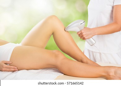 Close-up Of A Woman Receiving Laser Epilation Treatment On Customer Leg