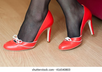 closeup of woman with red stilettos shoes