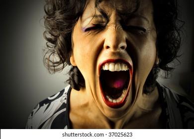 closeup of woman screaming