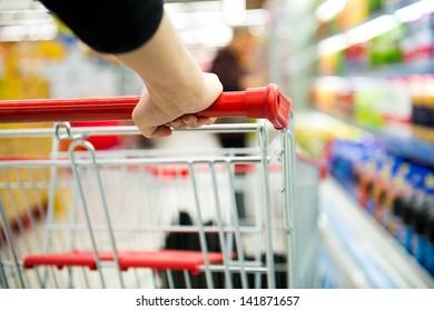 Closeup of woman with shopping cart.