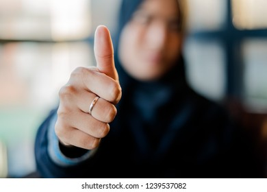 Closeup. woman showing thumbs up.Happy business person giving satisfied and supportive hand gesture.