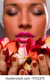 Close-up of woman smelling flower petals