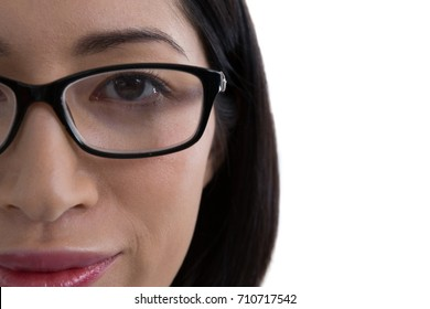 Close-up of woman in spectacle against white background