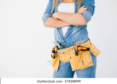 Close-up woman with tool belt