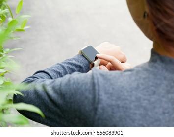 close-up woman using smart watch on hand new modern lifestyle