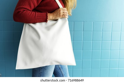 Closeup of woman with white tote bag