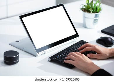 Close-up Of A Woman Working On Laptop At Workplace