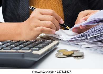 Closeup woman working with receipts